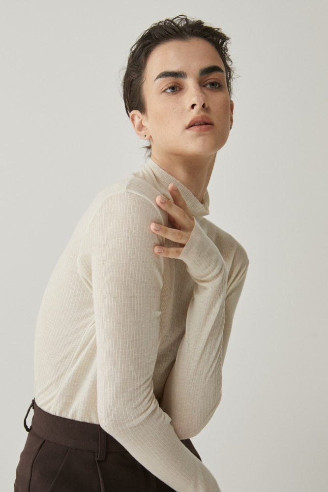 See through wool turtleneck in Cream